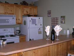 Open kitchen to the livingroom & dining room so you can cook and not miss out in the action!