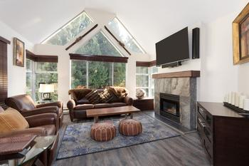Lavish two bedroom condo facing the slopes, with rare to find cathedral floor to ceiling windows!