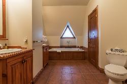 Ensuite bathroom located on second level with jacuzzi bath, separate shower and double sinks
