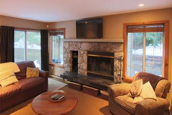 Cozy, family-friendly accommodations! Living Room with large flat screen TV over fireplace