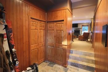Secure storage for ski/equipment in entryway.