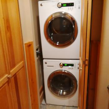 New stacking front load washer/dryer set.