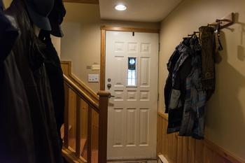 Entranceway, passing between garage, laundry and main door, has custom made benches, lots of hooks and a closet for hanging clothes.