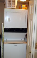 CONVENIENT Private Laundry closet with FULL SIZE Washer/Dryer, iron and ironing board, laundry basket, liquid detergent and fabric softner sheets.