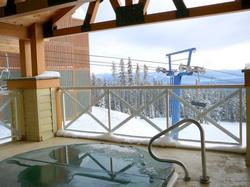 Relax in the covered hot tub with heated deck while enjoying the views of Hummingbird ski run and the Monashee Range.