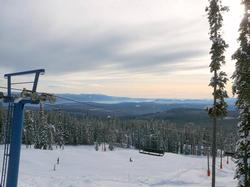 View of Hummingbird Ski run and the Monashee Range. Night skiing on Hummingbird is available on selected evenings.