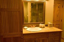 HIckory cabinets, slate counters, copper faucet and antique mirror add warmth and luxury to your bathroom time. Separate make-up and toilet areas add function and comfort.