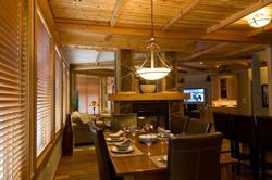 The Dining Room benefits from the open concept; but still has an intimate feeling with the stone fireplace as a separation to the Living Room.