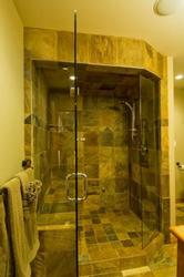 Large slate shower with steamer and frame-less glass. Listen to your favorite music through the built-in music system.