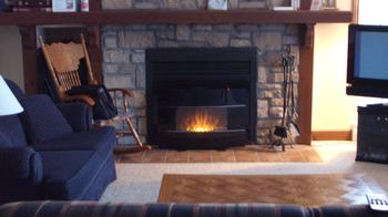Large stone wood burning fireplace & secondary electric fireplace with remote.