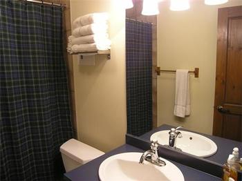 One of 2 full bathrooms .. This one has a bet bath.