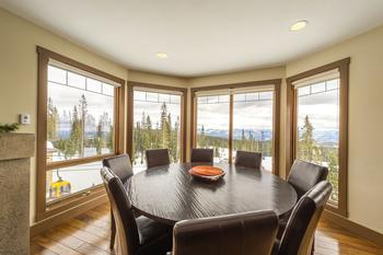 Dining area adjacent to living room and kitchen. View overlooking Happy Valley.