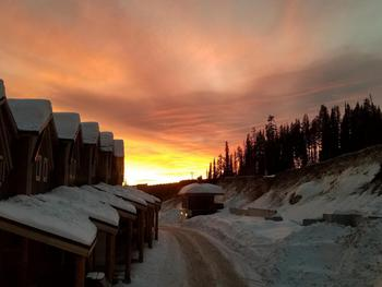 Upscale elegance and comfort awaits you at The Raven!  Big White sunset from the kitchen window.