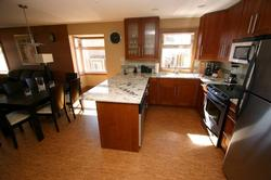 Granite Counter top, stainless appliances, enhance the functional Kitchen.