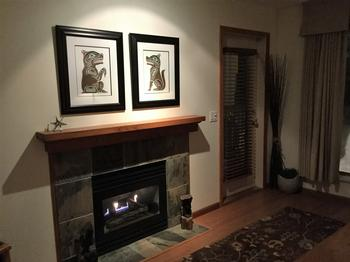 Lots of wood trim and original art create a pleasant environment.
