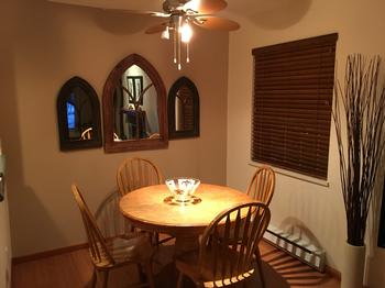 Dining table extends to accomodate 6 people with the addition of a leaf. The ceiling fan with dimmer allows you to set the mood.