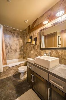 Main bathroom with shower and bathtub combination.