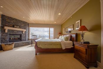 Surround yourself in luxury! Master suite with King bed, fireplace, TV and full ensuite bath.