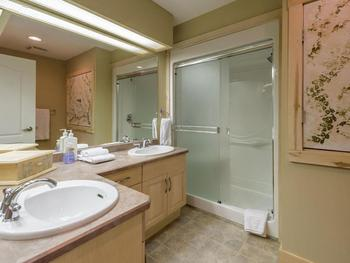 Main bathroom adjacent to Queen room with double shower.