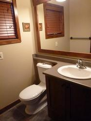 powder room on main floor near front entry.