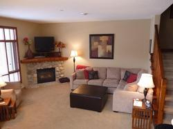 Warm and inviting living area with gas fireplace.