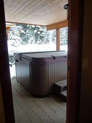 hot tub patio just outside the lower family room