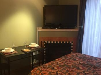 48 inch flat screen TV with GREAT Cable package and AppleTV. Natural Gas Fireplace Table sitting for 2