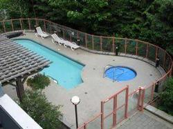Overhead view of Pool and Hot Tub area that backs onto private wooden area - very relaxing!!