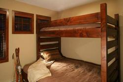 The upstairs bunk room has a single over queen bed. There is a large closet and chest of drawers for storage. Great room for the kids!