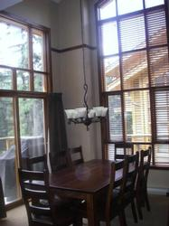 Great dining room with 2 storey windows. The table seats 8 with an additional 3 stools at the breakfast bar.
