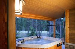 The lower patio features a 6 person hot tub. Relax and enjoy the outdoor air.