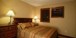 Spacious room upstairs with a queen size bed. This room has a large closet and a chest of drawers for storage.