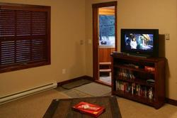 Great family room with 32inch LCD TV and DVD player. There are books, games and DVD's available for your use. The back door leads to the patio with the hot tub.