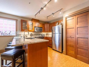 Breakfast bar and a well outfitted kitchen with everything a gourmet cook needs.