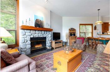 River Rock woodburning fireplace with warmly cushioned furniture makes this the coziest of places.