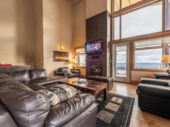 Spacious and comfortable lounge with natural gas flame fireplace and huge wall mounted plasma screen TV with DVDs.