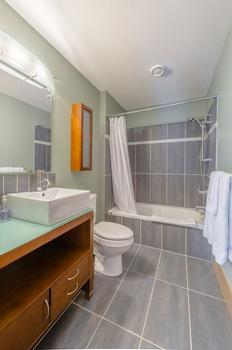 Loft bathroom with shower and bathtub combination.