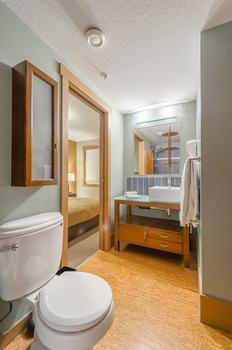Main bathroom with shower and bathtub. Off Queen room and front entrance.