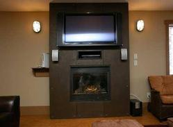 Unique gas fireplace with plasma TV mounted over top