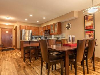 Dining area adjacent to kitchen and living room.