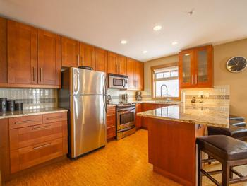 This kitchen is well equipped, perfect for those who love to cook.
