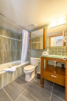 Queen en-suite with shower and bathtub combination.