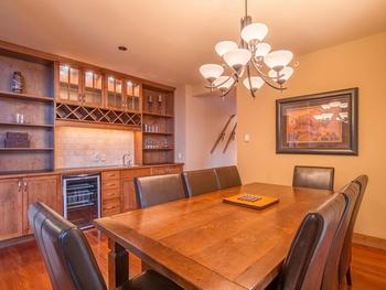 Stylish dining room with maple shake style cabinetry, wet bar and wine cooler. Perfect place for dining or playing games. First balcony off dining area.