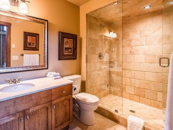 Master Ensuite complete with steam shower, vanity with plenty of storage and heated tiled flooring