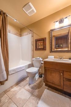Queen room en-suite with shower and bathtub combination.