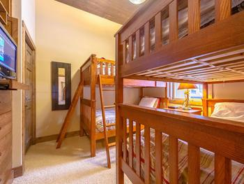 The Bunk room has 2 sets of single bunk beds, TV and DVD with easy access to bathroom across the hall.