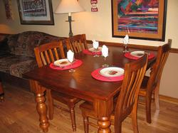 Solid wood Kitchen table awaits your family meal, 6 chairs. There are 2 leaves under the bed if you need extra space, and deck chairs can be used for guests