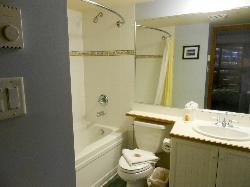 Master bath (on suite) with deep soaker tub, shower with curved shower rod, title floor, hair dryer, lots of towels and supplies.