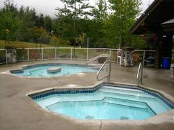 2 hot tubs, there is a third one also on the other side of the pool. The ski slope is behind the hot tubs, this picture was taken in the fall before the snowfall.