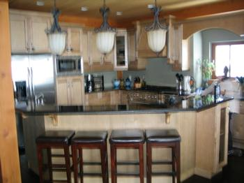 Large kitchen with seating for 4 at kitchen counter plus 10 on main table